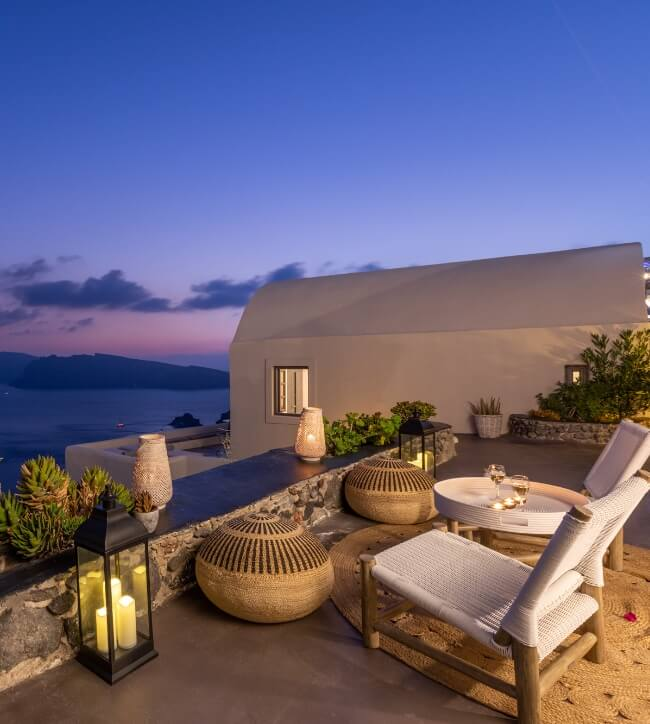 The breathtaking view from the balcony of the apartments of the boutique hotel of Nostos Apartments in Oia Santorini