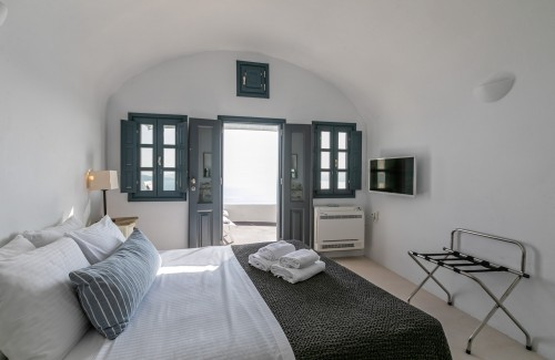 The lavish double bed offered from Nostos Apartments in Oia Santorini