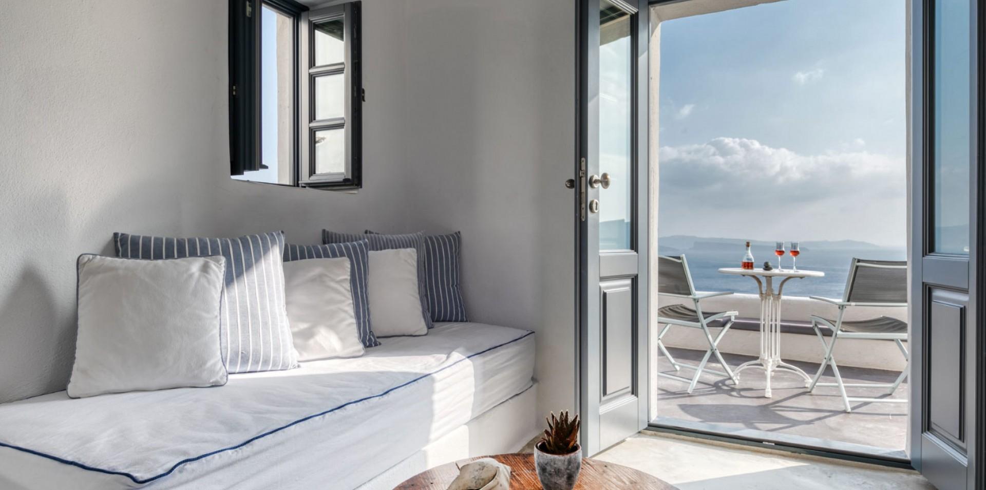 The interior of the luxury suite of Nostos Apartments in Oia Santorini
