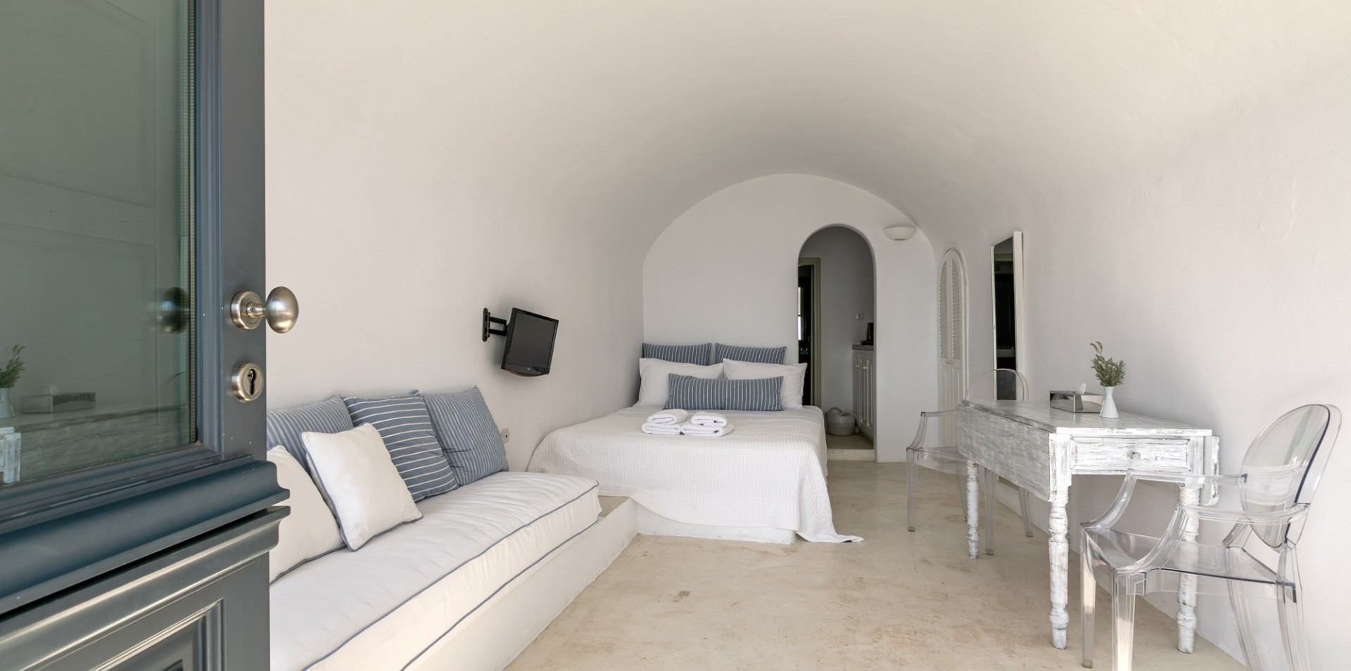 The interior of the luxury studio of Nostos Apartments in Oia Santorini