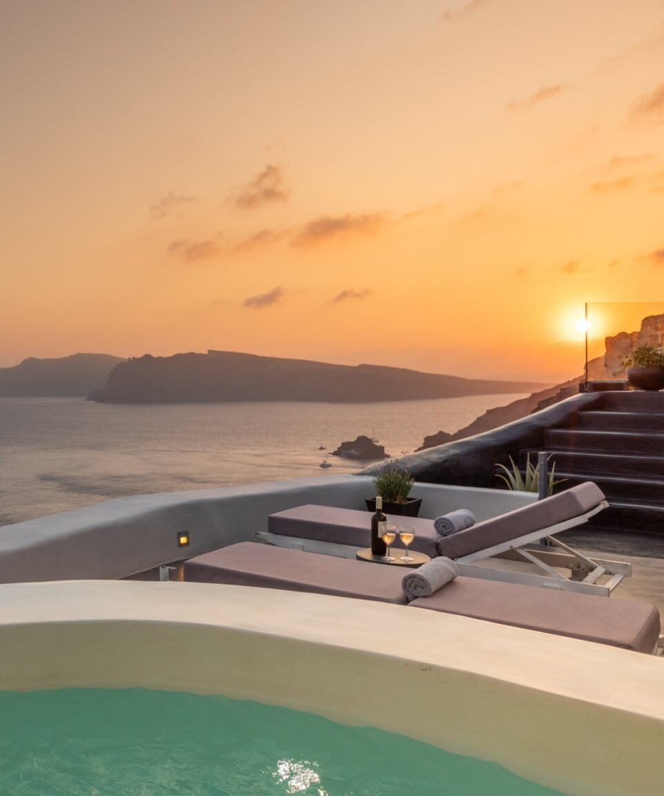 Breathtaking view from the balcony of the luxurious apartments of Nostos Apartments in Oia Santorini