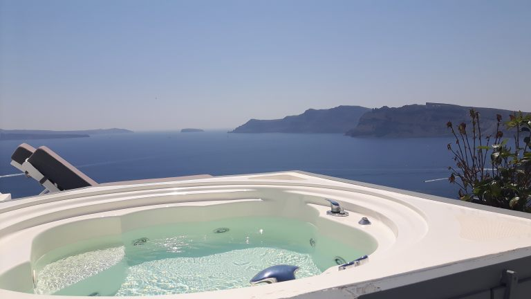 The private outdoor jacuzzi in the luxury Nostos Apartments in Oia Santorini