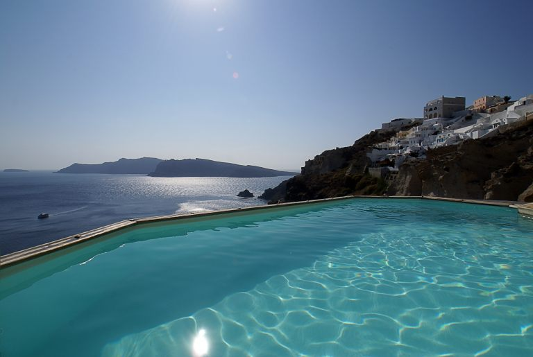 The magnificent view from the outdoor pool of the luxury Nostos Apartments in Oia Santorini