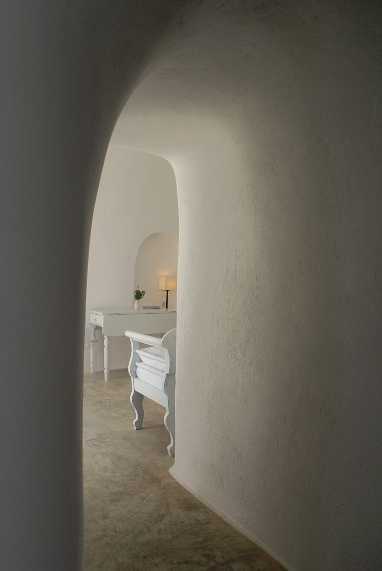 The traditional cave house interior of the luxury Nostos Apartments in Oia Santorini