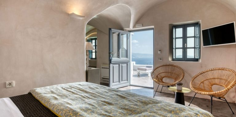 The marvelous double bed inside the luxurious apartments of Nostos Apartments in Oia Santorini
