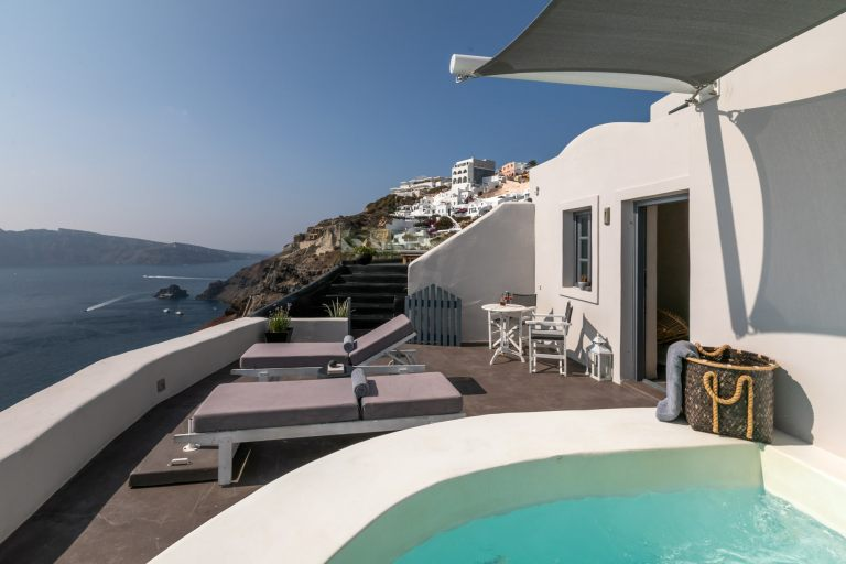 The magnificent balcony with the private hot tub and sunbeads from Nostos Apartments in Oia Santorini