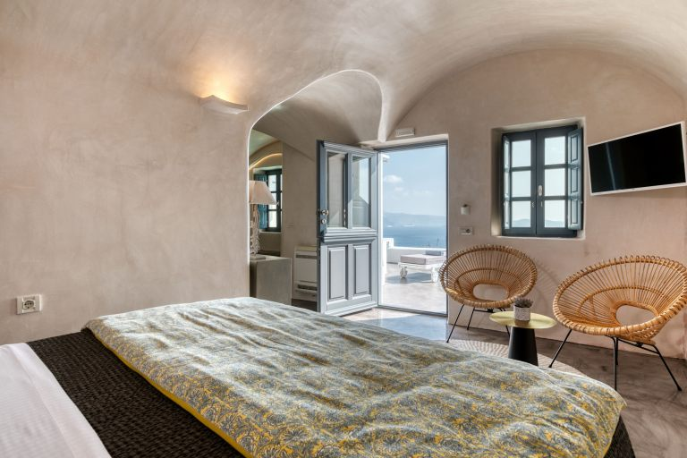 The superb double bed inside the apartments of Nostos Apartments in Oia Santorini