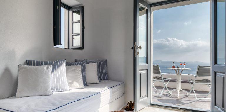 The interior of the luxury Junior Suite of Nostos Apartments in Oia Santorini