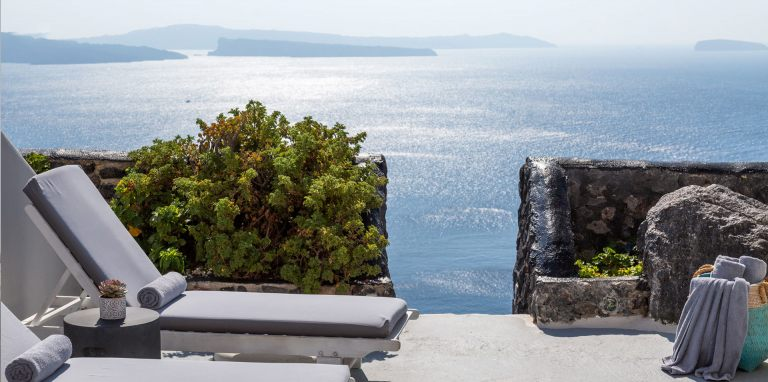 The breathtaking view of Caldera from the luxury apartments of Nostos Apartments in Oia Santorini