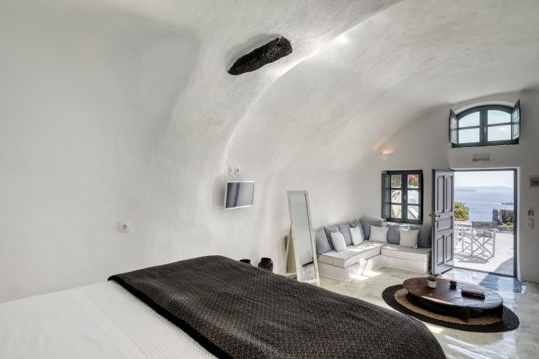 The amazing bedroom of the luxury apartments of Nostos Apartments in Oia Santorini