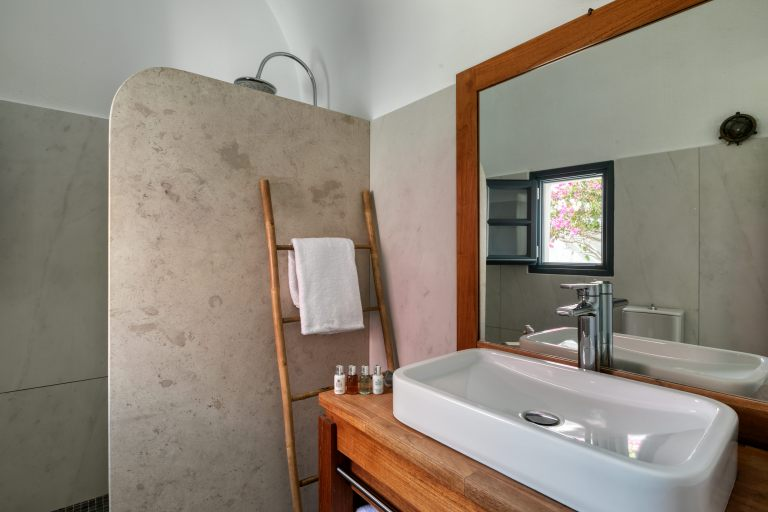 The cozy bathroom inside the luxury apartment of Nostos Apartments in Oia Santorini