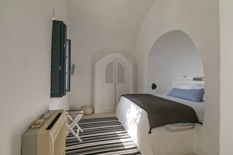 The lovely bedroom of the luxury apartment of Nostos Apartments in Oia Santorini